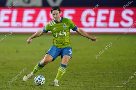 Seattle Sounders midfielder Gustav Svensson takes a shot during the second half of an MLS soccer match, in Carson, Calif