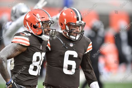 Cleveland Browns wide receiver Jarvis Landry, left, reacts beside quarterback Baker Mayfield after an incomplete pass in the end zone during an NFL football game against the Las Vegas Raiders, in Cleveland. The Raiders won 16-6