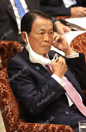 Japanese Finance Minister Taro Aso listens to a question at Upper House's budget committee session at the National Diet in Tokyo on Thursday, November 5, 2020.