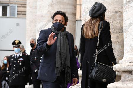 Stock Image of Funeral of Gigi Proietti, the actor Enrico Brignano attends the funeral in Piazza del Popolo at the Basilica of Santa Maria in Montesanto, called 'Church of the artists'