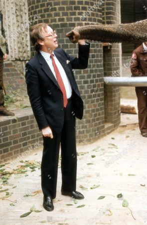 John Gummer John Selwyn Gummer With Elephant Dilberta At London Zoo In Aid Of The Helping The Earth Campaign In 1993.