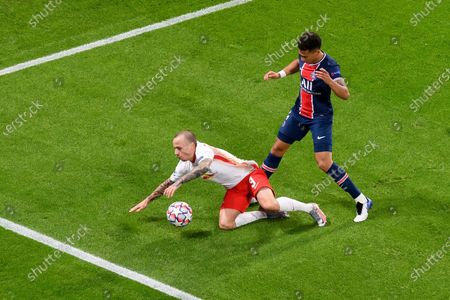 Angelino (RB Leipzig) and Presnel Kimpembe (FC Paris Saint-Germain) battle for the ball