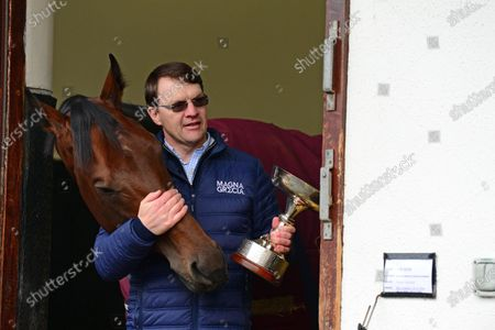 BALLYDOYLE STABLES 5-November-2020. A delighted AIDAN O'BRIEN pictured with the trophy for Champion Flat Trainer 2020, his 23rd time to achieve the feat with the offical presentation at Naas on 7th November. Aidan is also pictured with his latest Group 1 winner, VAN GOGH in his stable admiring the trophy.