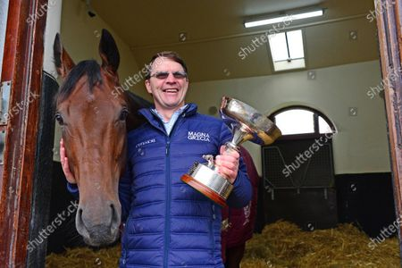 Stock Photo of BALLYDOYLE STABLES 5-November-2020. A delighted AIDAN O'BRIEN pictured with the trophy for Champion Flat Trainer 2020, his 23rd time to achieve the feat with the offical presentation at Naas on 7th November. Aidan is also pictured with his latest Group 1 winner, VAN GOGH in his stable admiring the trophy.