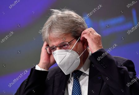 European Commissioner for Economy Paolo Gentiloni puts on his face mask after a media conference on Autumn 2020 Economic Forecast at EU headquarters in Brussels
