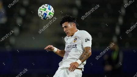 Galaxy forward Cristian Pavon heads the ball during the first half of an MLS soccer match against the Seattle Sounders, in Carson, Calif