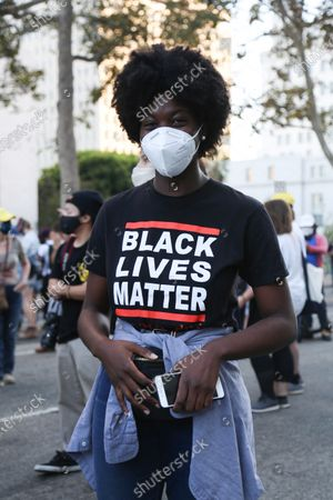 Black Lives Matter supporters celebrate the voting out of Los Angeles DA Jackie Lacey