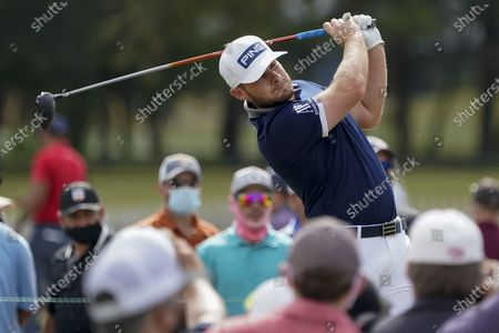 Tyrrell Hatton watches his tee shot on the 10th hole during the first round of the Houston Open golf tournament, in Houston