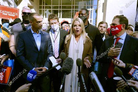 Former Florida Attorney General Pam Bondi, center, speaks about a court order obtained to grant President Donald Trump's campaign more access to vote counting operations at the Pennsylvania Convention Center, in Philadelphia, following Tuesday's election