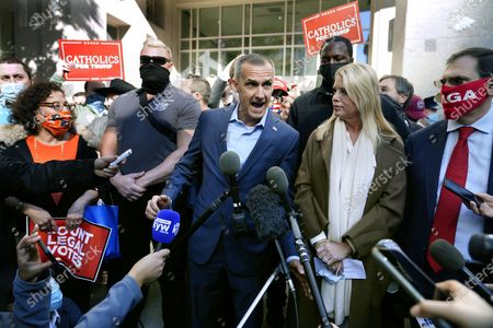 President Donald Trump's campaign advisor Corey Lewandowski, center, speaks about a court order obtained to grant more access to vote counting operations at the Pennsylvania Convention Center, in Philadelphia, following Tuesday's election. At right is former Florida Attorney General Pam Bondi