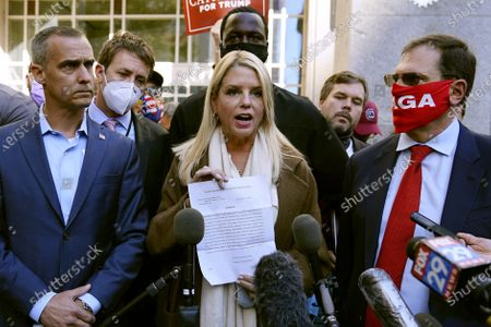 Former Florida Attorney General Pam Bondi displays a court order granting President Donald Trump's campaign more access to vote counting operations at the Pennsylvania Convention Center, in Philadelphia, following Tuesday's election