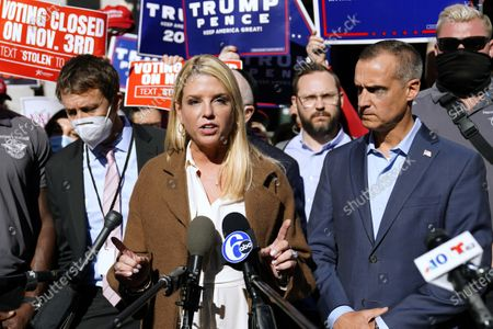 Former Florida Attorney General Pam Bondi speaks outside the Pennsylvania Convention Center where votes are being counted, in Philadelphia, following Tuesday's election. At right is President Donald Trump's campaign advisor Corey Lewandowski