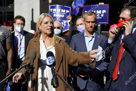 Former Florida Attorney General Pam Bondi speaks outside the Pennsylvania Convention Center where votes are being counted, in Philadelphia, following Tuesday's election. Beside her, right, is President Donald Trump's campaign advisor Corey Lewandowski