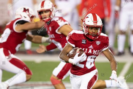 Miami (Oh) Redhawks running back Kevin Davis (26) runs the ball during an NCAA football game against the Ball State Cardinals on in Oxford, Ohio