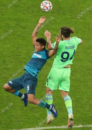 Lazio player Vedat Muriqi (right) and Zenit player Wilmar Barrios (left) during the match.November 04, 2020. Russia, St Petersburg