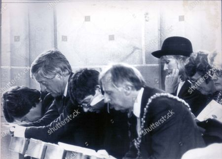 Russell Harty Memorial Service -blackbrow Cathedral-michael Parkinson (l) With Wife Mary (behind With Hat) During Prayers....television Presenter (1980 -1989) 1987