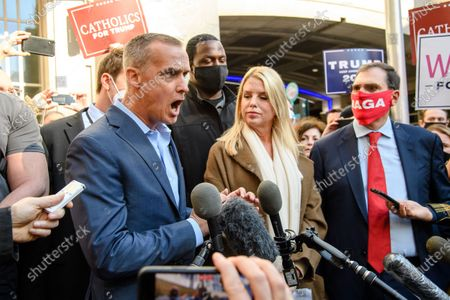 Trump campaign advisor Corey Lewandowski , left, speaks after former Florida Attorney General Pam Bondi showed reporters a court order granting President Donald Trump's campaign more access to vote counting operations at the Pennsylvania Convention Center, Thursday, Nov. 5, 2020, in Philadelphia, PA.