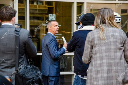 Trump campaign advisor Corey Lewandowski , left, shows reporters a court order granting President Donald Trump's campaign more access to vote counting operations at the Pennsylvania Convention Center, Thursday, Nov. 5, 2020, in Philadelphia, PA.