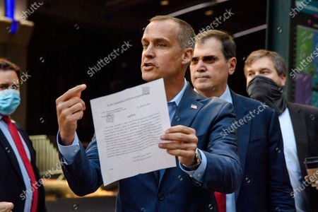 Trump campaign advisor Corey Lewandowski holds a court order granting President Donald Trump's campaign more access to vote counting operations at the Pennsylvania Convention Center, Thursday, Nov. 5, 2020, in Philadelphia, PA.
