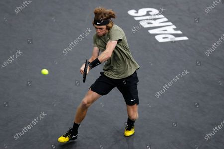 Russia's Andrey Rublev returns the ball to Switzerland's Stan Wawrinka during the third round of the Paris Masters tennis tournament at the Bercy Arena in Paris