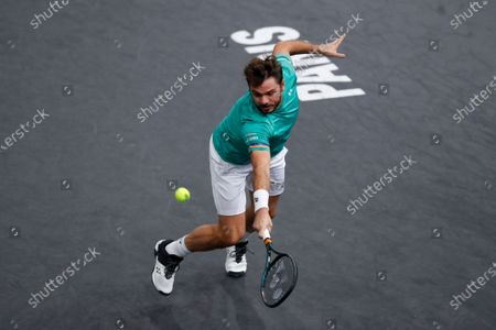 Switzerland's Stan Wawrinka returns the ball to Russia's Andrey Rublev during the third round of the Paris Masters tennis tournament at the Bercy Arena in Paris
