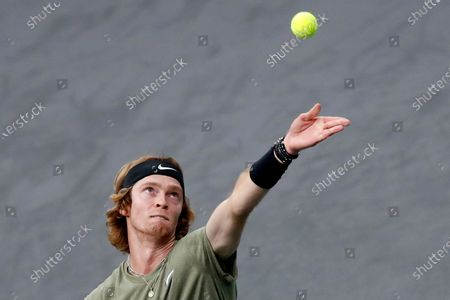 Russia's Andrey Rublev serves to Switzerland's Stan Wawrinka during the third round of the Paris Masters tennis tournament at the Bercy Arena in Paris