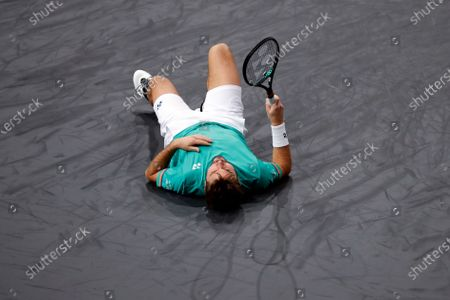 Switzerland's Stan Wawrinka lies after falling as he plays against Russia's Andrey Rublev during the third round of the Paris Masters tennis tournament at the Bercy Arena in Paris