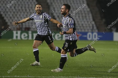 Stock Image of PAOK's Andrija Zivkovic, right, celebrates after scoring his side's second goal during the Europa League group E soccer match between PAOK and PSV Eindhoven at Toumba stadium in the northern city of Thessaloniki, Greece