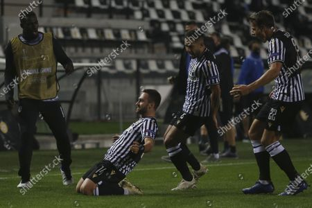 Stock Photo of PAOK's Andrija Zivkovic, bottom, celebrates with his teammates after scoring his side's second goal during the Europa League group E soccer match between PAOK and PSV Eindhoven at Toumba stadium in the northern city of Thessaloniki, Greece