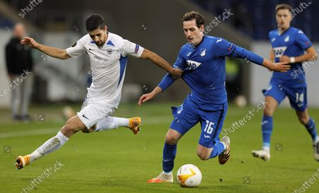 Liberec's Martin Koscelnik (L) in action against Hoffenheim's Sebastian Rudy (C) during the UEFA Europa League group L soccer match between TSG 1899 Hoffenheim and FC Slovan Liberec in Sinsheim, Germany, 05 November 2020.