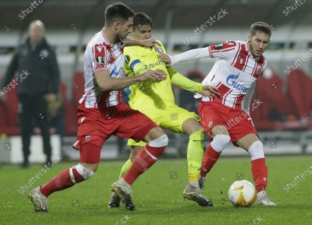 Red Star's Milos Degenek (L) and Veljko Nikolic (R) of Red Star in action against Alessio Castro-Montes (C) of Gent during the UEFA Europa League group L match between Red Star Belgrade and KAA Gent in Belgrade, Serbia, 05 November 2020.