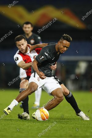 Feyenoord's Uros Spajic, rear, restrains CSKA's Chidera Ejuke during the Group K Europa League soccer match between Feyenoord and CSKA Moscow at De Kuip stadium in Rotterdam, Netherlands