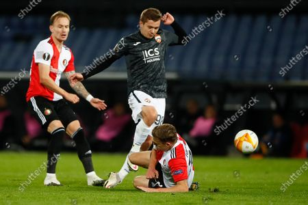 CSKA's Ivan Oblyakov, center, jumps to avoid a collision with Feyenoord's Uros Spajic as Feyenoord's Mark Diemers, left, looks on during the Group K Europa League soccer match between Feyenoord and CSKA Moscow at De Kuip stadium in Rotterdam, Netherlands