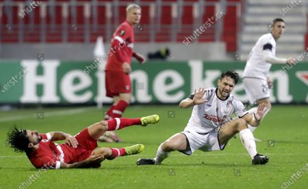 Lior Refaelov (L) of Royal Antwerp following a tackle by James Holland (R) of LASK during the UEFA Europa League group J match between Royal Antwerp and LASK Linz in Antwerp, Belgium, 05 November 2020.