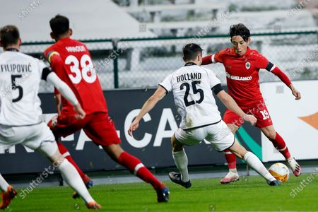 Royal Antwerp's Koji Miyoshi, right, is challenged by LASK's James Holland during the Europa League Group J soccer match between Antwerp and LASK at the Bosuil stadium in Antwerp, Belgium
