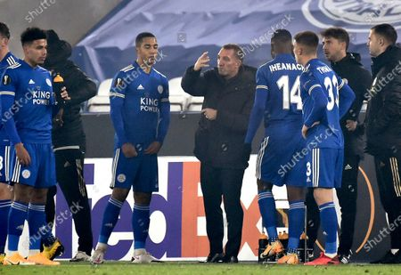 Leicester's head coach Brendan Rodgers, center, gestures during the Europa League Group G soccer match between Leicester City and Sporting Braga at the King Power Stadium in Leicester, England
