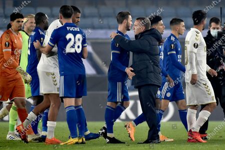 Leicester's head coach Brendan Rodgers, center, shakes hands with his players after the Europa League Group G soccer match between Leicester City and Sporting Braga at the King Power Stadium in Leicester, England