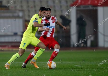 Gent's Roman Yaremchuk, left, duels for the ball with Red Star's Milos Degenek during the Europa League group L soccer match between Red Star and Gent at the Rajko Mitic Stadium in Belgrade, Serbia