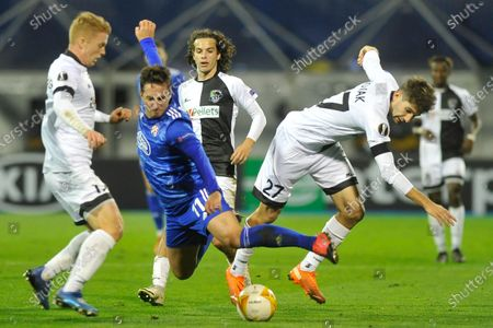 Wolfsberger's Michael Novak, right, is challenged by Dinamo Zagreb's Mario Gavranovic during the Europa League Group K soccer match between Dinamo Zagreb and Wolfsberg at the Maksimir stadium in Zagreb, Croatia