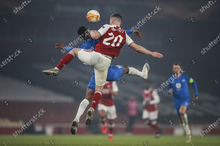 Arsenal's Shkodran Mustafi, foreground, and Molde's Leke James jump for the ball during the Europa League group B soccer match between Arsenal and Molde at the Emirates tadium in London