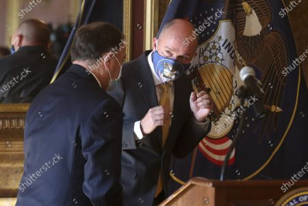 Gov. Gary Herbert, left, and Gov.-elect Spencer Cox talk as they leave a news conference where Cox and Lt. Gov.-elect Deidre Henderson announced details related to their upcoming transition of leadership from the Gold Room at the Utah State Capitol, in Salt Lake City. Cox, who won the governor's race this week, said he is prepared to continue the fight against COVID-19 when he succeeds Herbert in January. He said he hopes to focus on ramping up testing, adding more contact tracers and implementing vaccine distribution