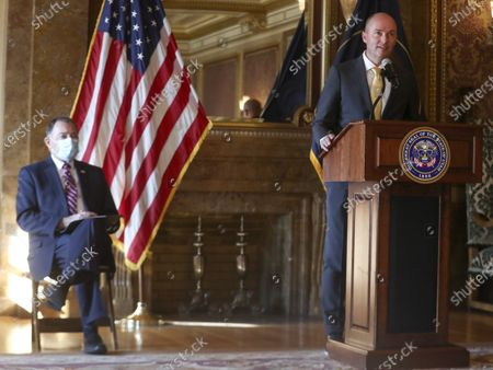 Gov. Gary Herbert, left, listens as Gov.-elect Spencer Cox announces details related to the upcoming transition in the Gold Room at the Utah State Capitol, in Salt Lake City. Cox, who won the governor's race this week, said he is prepared to continue the fight against COVID-19 when he succeeds Herbert in January. He said he hopes to focus on ramping up testing, adding more contact tracers and implementing vaccine distribution