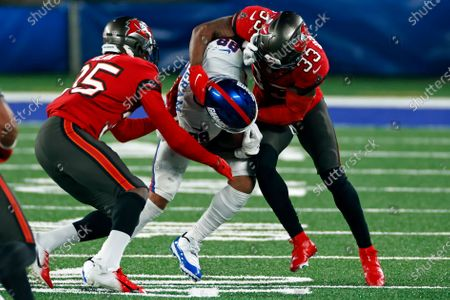 New York Giants tight end Evan Engram (88) is tackled by Tampa Bay Buccaneers safety Jordan Whitehead (33) during an NFL football game against the Tampa Bay Buccaneers, in East Rutherford, N.J
