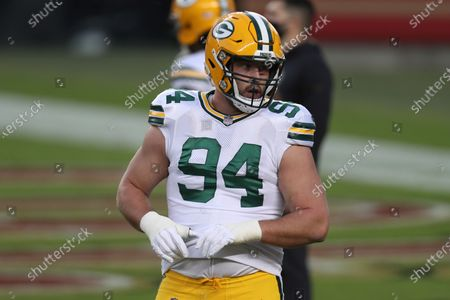 Green Bay Packers defensive end Dean Lowry (94) warms up before an NFL football game against the San Francisco 49ers in Santa Clara, Calif