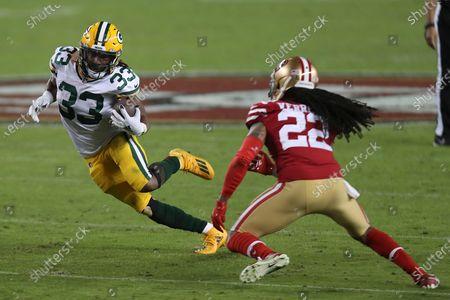 Green Bay Packers running back Aaron Jones (33) runs against San Francisco 49ers' Jason Verrett during an NFL football game in Santa Clara, Calif