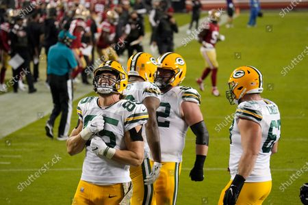 Green Bay Packers tight end Robert Tonyan (85) celebrates after tight end Marcedes Lewis, middle, scored a touchdown against the San Francisco 49ers during the first half of an NFL football game in Santa Clara, Calif