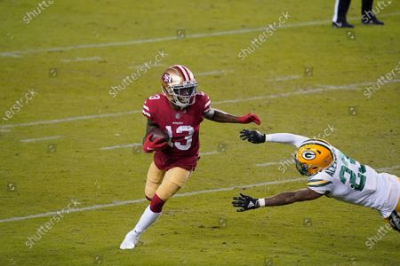 Stock Picture of San Francisco 49ers wide receiver Richie James (13) runs against Green Bay Packers cornerback Jaire Alexander (23) during the first half of an NFL football game in Santa Clara, Calif