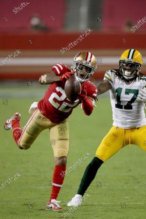 San Francisco 49ers cornerback Jason Verrett (22) intercepts a pass in front of Green Bay Packers wide receiver Davante Adams (17) during an NFL football game, in Santa Clara, Calif