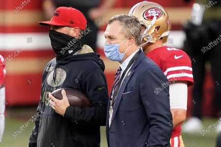 Stock Picture of San Francisco 49ers head coach Kyle Shanahan, left, and general manager John Lynch watch players warm up before an NFL football game against the Green Bay Packers in Santa Clara, Calif