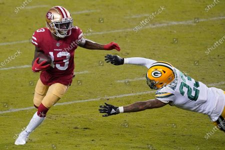 Stock Image of San Francisco 49ers wide receiver Richie James (13) runs against Green Bay Packers cornerback Jaire Alexander (23) during the first half of an NFL football game in Santa Clara, Calif